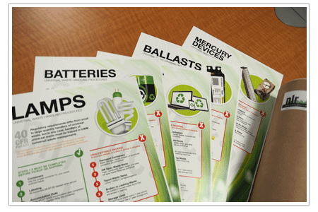 Picture of NLR's compliance posters for lamps, batteries, E-Waste, ballasts, and mercury containing devices. NLR provides customers with both english and spanish compliance posters for universal waste recycling.