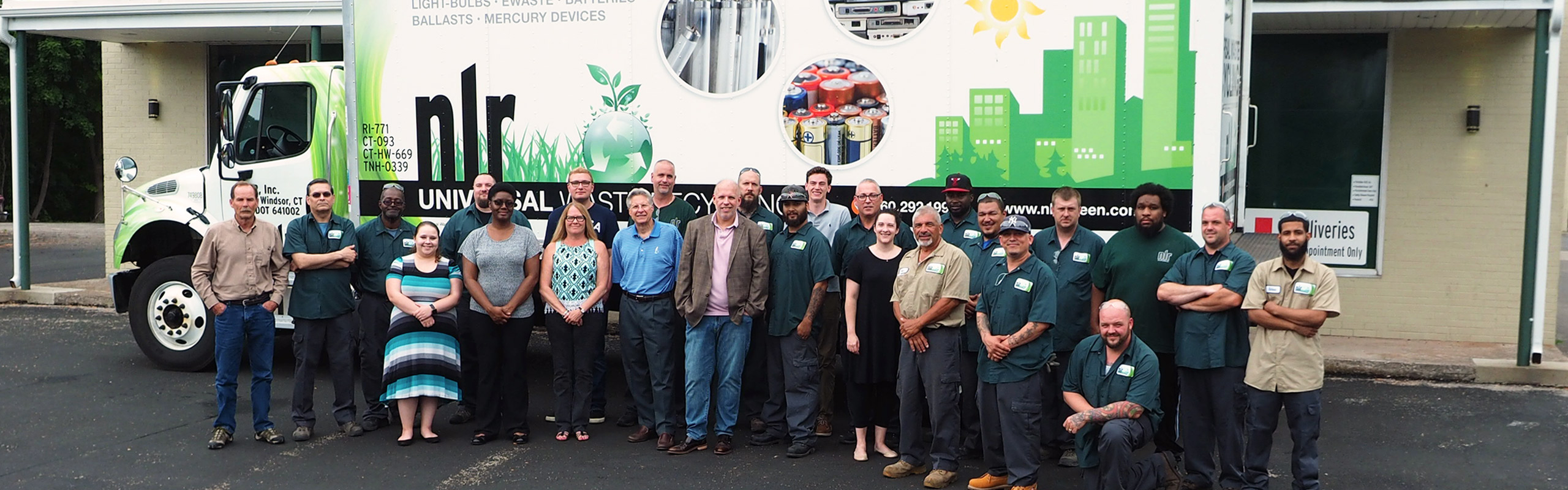 A picture of the nlr staff including the office staff, UWH workers, and lamp processing team. NLR works tirelessly to make sure recycling your universal waste is a painless process.