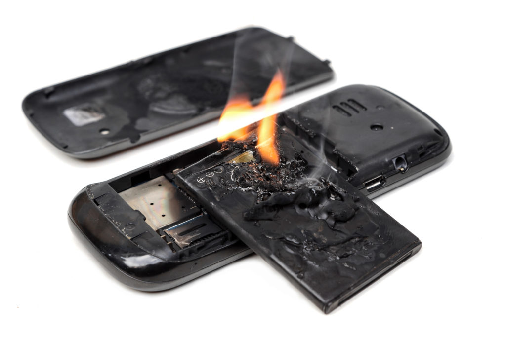 A picture of a burning cellphone battery. Improperly stored or untaped battery terminals can cause short circuits and fires. Batteries must be stored properly to avoid risk of fires when recycling.
