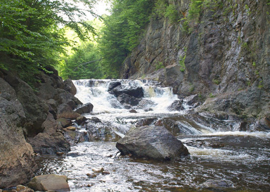 A picture of a small waterfall in a river. A small amount of mercury can greatly damage a body of water. NLR recycles universal waste to keep mercury out of the environment.