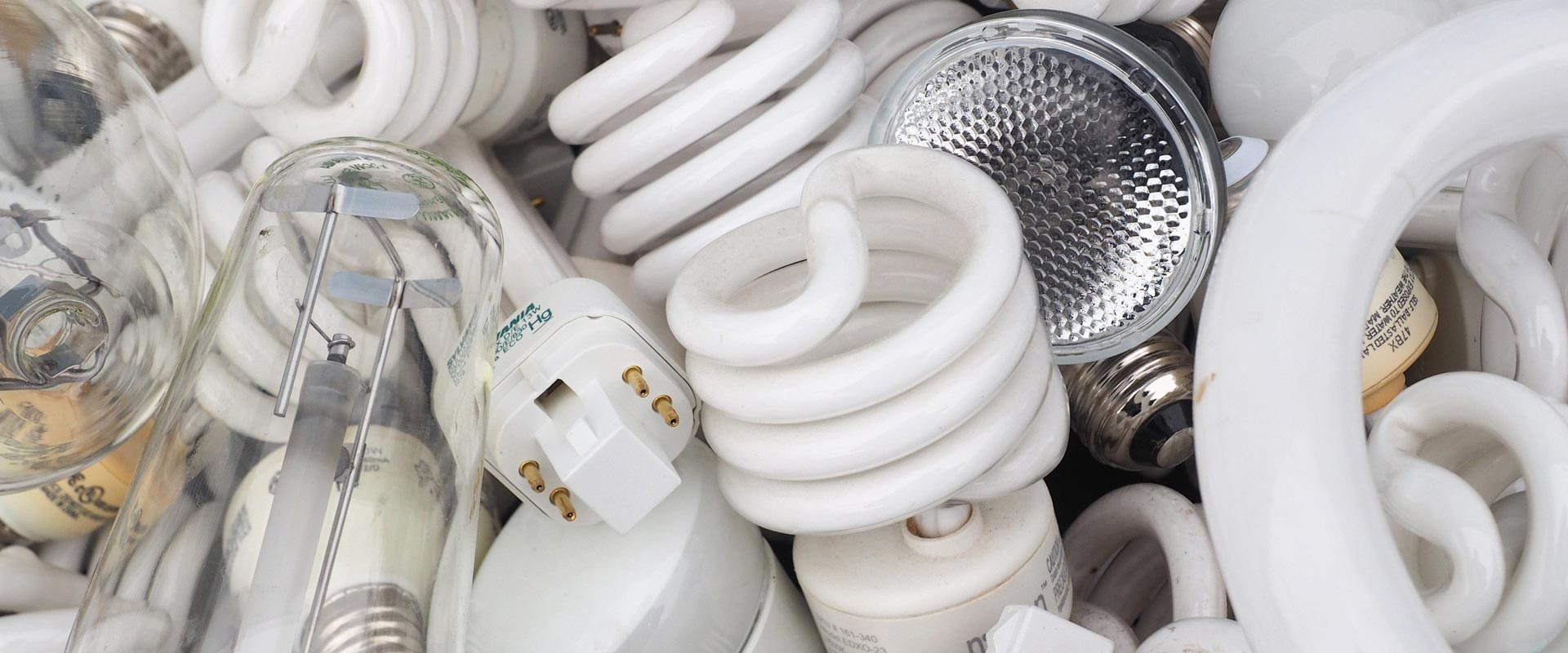 A picture of compact fluorescent blubs, pin lamps, hid bulbs, and halgoen bulbs. NLR recycles lamps and fluorescent bulbs.