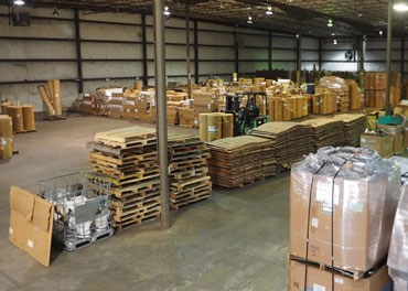 A picture of the inside of NLR's UWH Warehouse. This is where NLR receives, weighs, and separates waste streams. Responsible for handling lamp recycling, battery recycling, electronics recycling, and mercury device recycling.