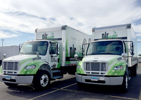 Two NLR box trucks used for picking up universal waste recycling in areas not accessible by tractor trailer.