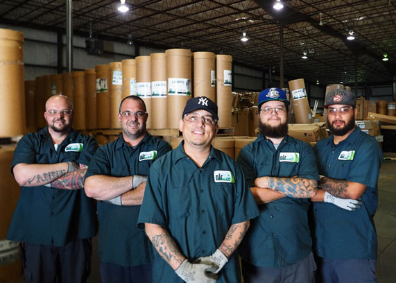 A picture of the UWH Warehouse team. They recieve and sort lamps, electronics, batteries, ballasts, and mercury devices.