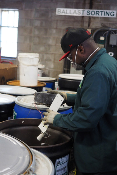 A picture of one of NLR's processing facility sorting ballasts. NLR recycles both Non-PCB and PCB ballasts.