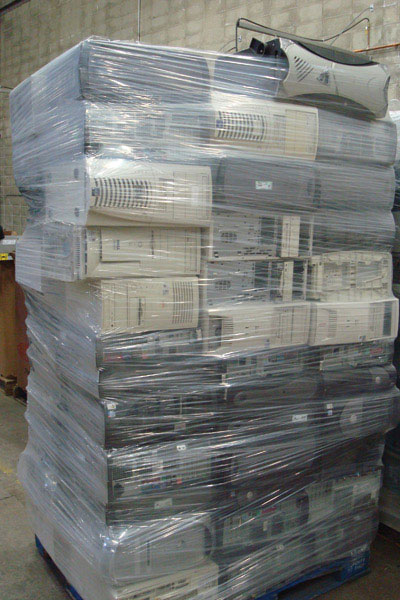 A picture of stacked computer towers and CPU's wrapped in plastic. NLR recycles electronics including computers, consumer electronics, office electronics, and more.