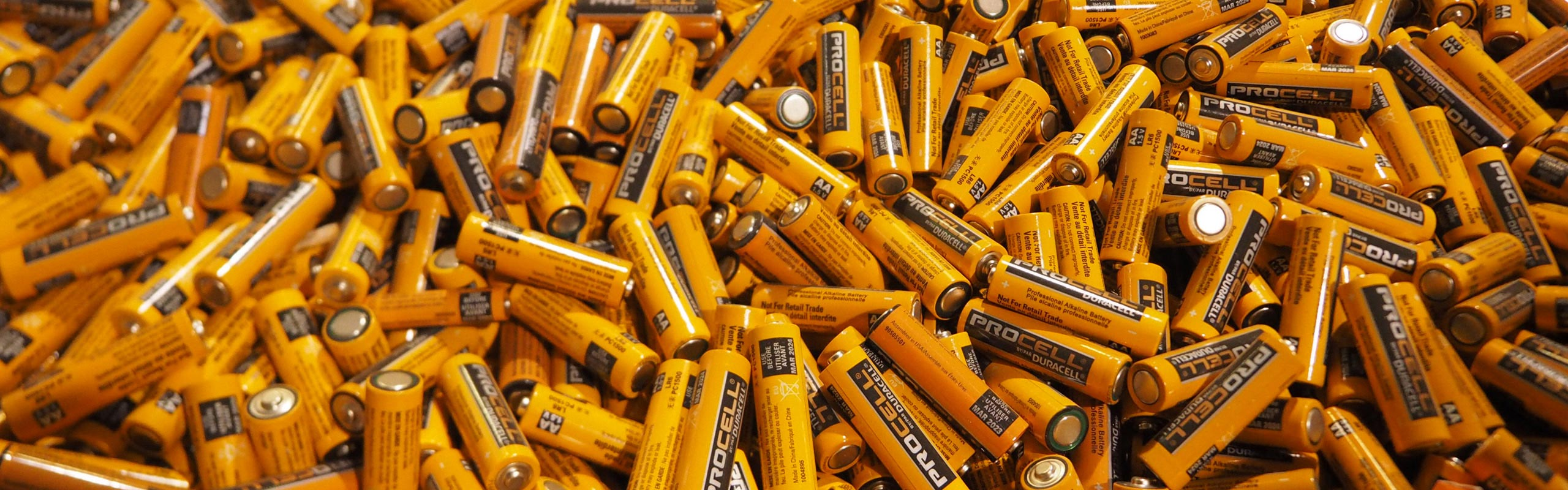 A picture of a large bin of all AA alkaline batteries. NLR recycles alkaline batteries and all other battery types.